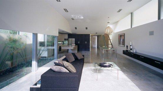 Moderna casa de playa minimalista casa de onda por ndm for Imagenes de interiores de casas minimalistas