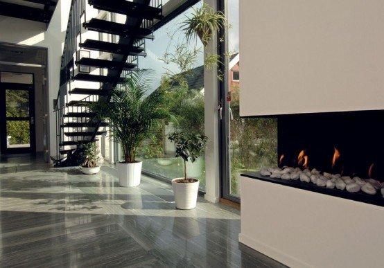 Fachada de casa asi tica moderna con toques de lujo for Lujo interiores minimalistas