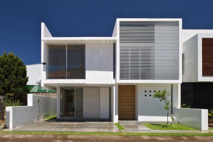 Minimalismo arquitect nico y geom tricas presentaciones for Frentes de casas minimalistas