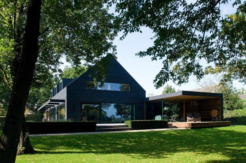 Fachada de Casa vieja transformada en una residencia moderna